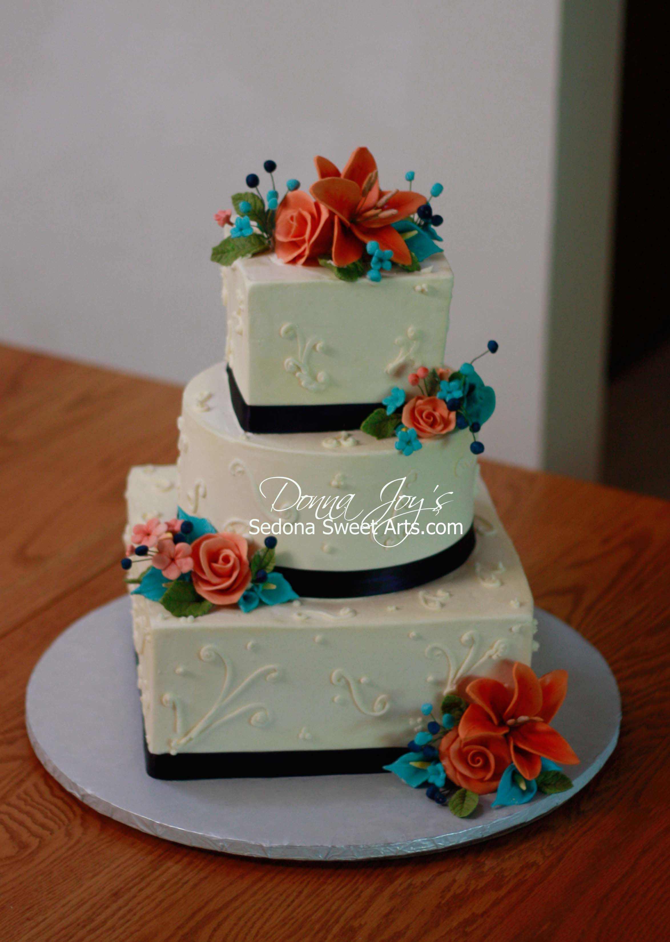 Square Buttercream adorned with Custom colored Sugar Flowers