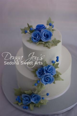 Blue Cascade sugar flower on a smooth Buttercream wedding cake