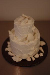 Stormy Love, textured Buttercream Wedding Cake by Donna Joy ~ Sedona Sweet Arts. Handmade White chocolate seashells adorn this beautiful cake.