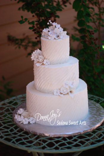 Buttercream Wedding Cake angled texture with hand sculpted sugar flowers by Donna Joy
